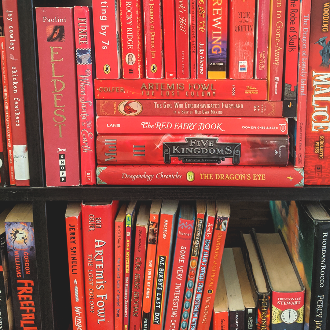 Bookstagram photo featuring red books on a shelf
